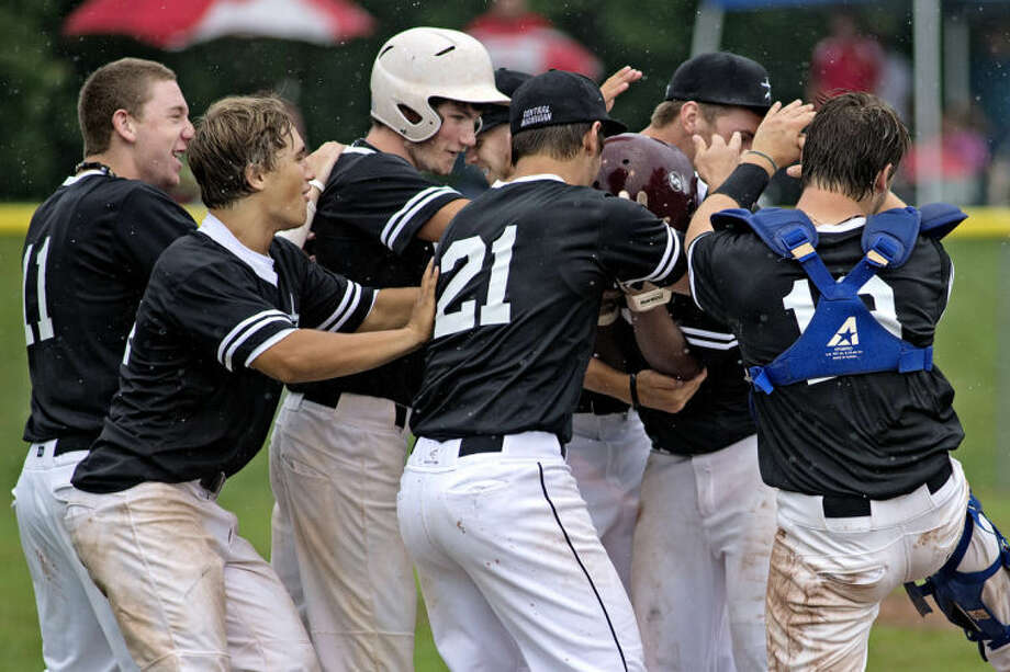 NICK KING | nking@mdn.netThe Central Michigan All-Stars celebrate their victory over Berryhill Sunday at Northwood University. The Stars won the semifinal game 4-3. Photo: Nick King/Midland  Daily News