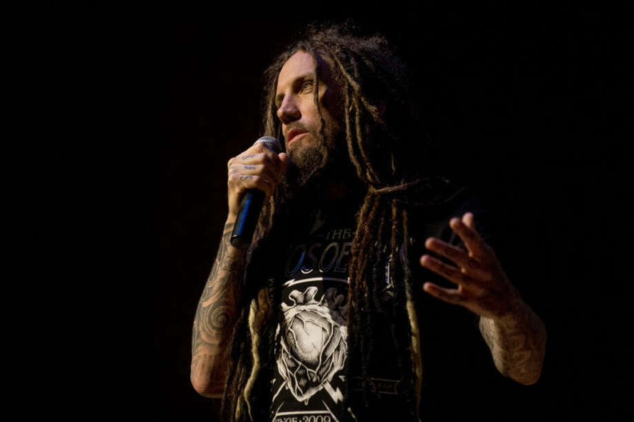 "NEIL BLAKE | nblake@mdn.netBrian ""Head"" Welch talks at Bullock Creek High School auditorium about his transformation from a drug addict to a follower of Jesus on Wednesday. Welch spoke openly about his band, Korn, and their rise to fame and his  struggles with alcohol and substance abuse. Photo: Neil Blake/Midland  Daily News"