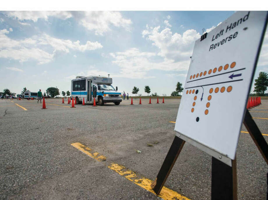 Photo providedA driver maneuvers through the left hand reverse obstacle in the 38th annual Small Bus Roadeo in Mount Pleasant. Photo: Sara J. Gross