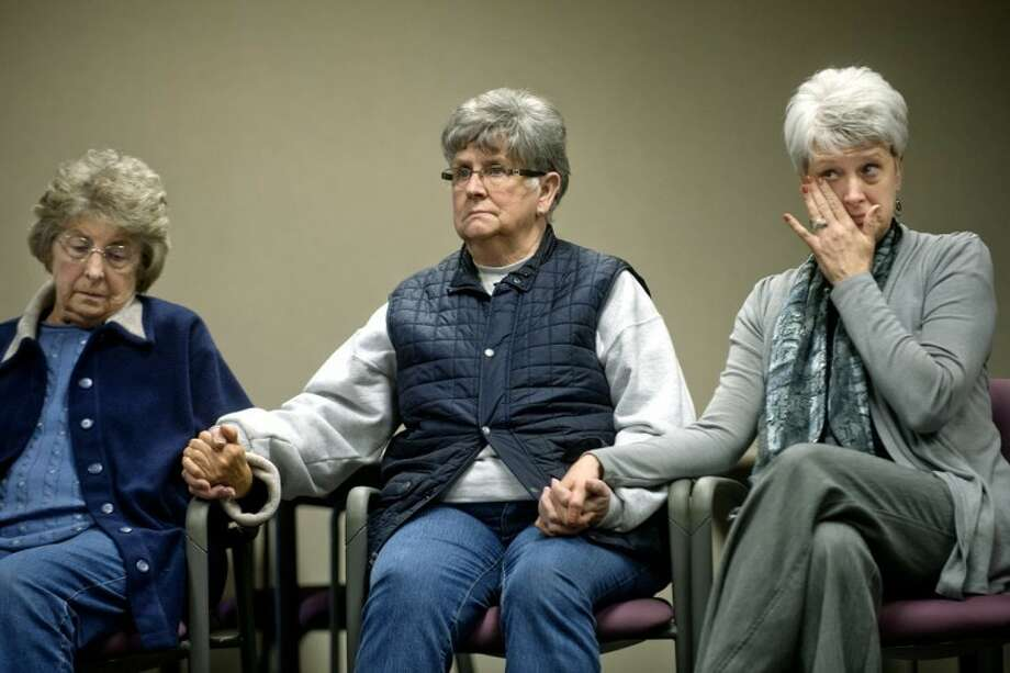 NICK KING | nking@mdn.netFamily members of a missing Saginaw Township woman look on during a press conference Wednesday at the Midland Law Enforcement Center. Leigh Catherine Swanson, 45, was reported missing by her family on Nov. 20. Photo: Nick King/Midland  Daily News