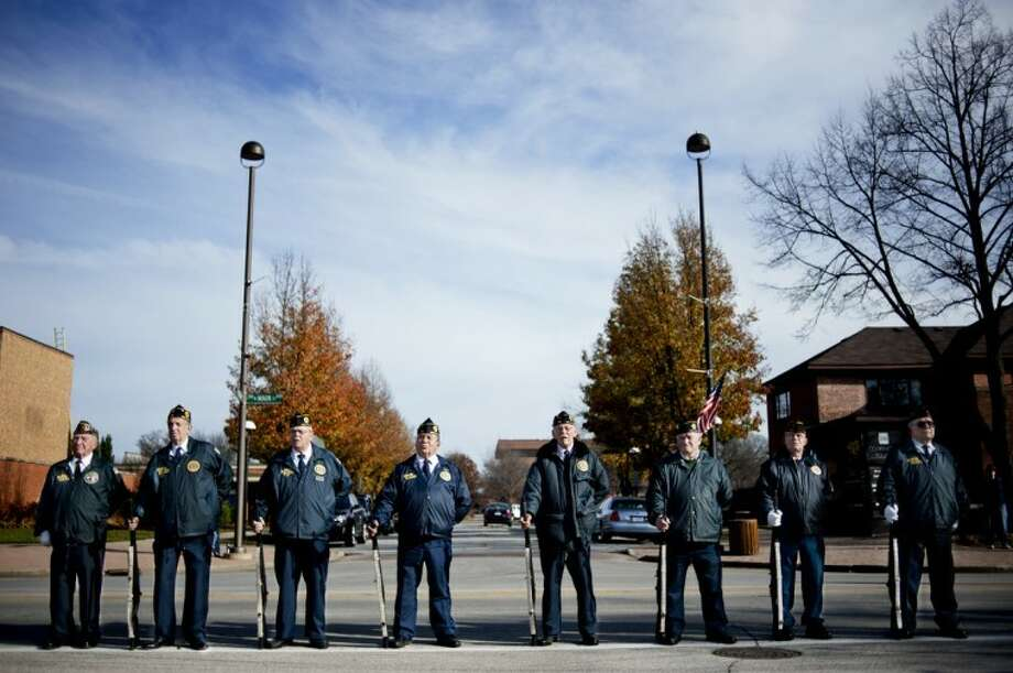 Zack Wittman | for the Daily NewsLocal veterans stand in a line during the Veterans Day ceremony in front of the Midland County Courthouse on Sunday. The ceremony took place on the 11th hour of the 11th day of the 11th month, holding true to tradition.