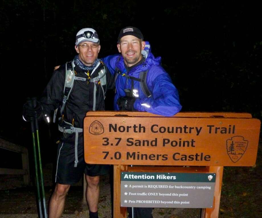 Eric Carlson and Roy Kranz are shown at the end of their more than 85-mile hike.