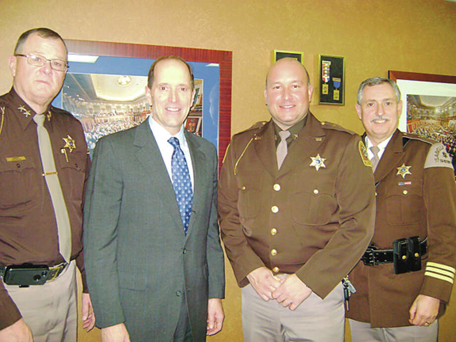 Photo providedFrom left, Roscommon County Sheriff Randy Stevenson, U.S. Congressman Dave Camp, R-Midland, Midland County Sheriff Scott Stephenson and Isabella County Sheriff Leo Mioduszewski.
