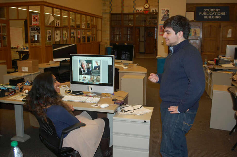 CINDY CRAIN NEWMAN | for the Daily News Midland's Peter Shahin assumes the position of editor in chief of the U of M Michigan Daily newspaper this month. He discusses photo layout in the newsroom with Teresa Mathew, a junior from California. Photo by Cindy Crain Newman