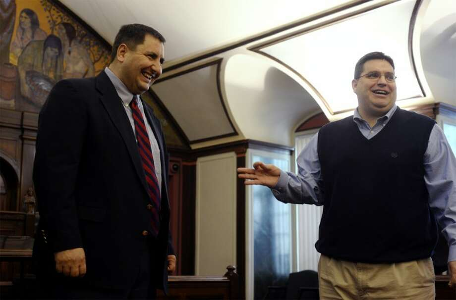 In this file photo, 98th District state Rep. Republican Jim Stamas, left, jokes with his brother, former Sen. Tony Stamas, in the Midland County Courtroom. Tony Stamas' career as a senator has ended due to term limits. He is now working on new opportunities, but is not saying what those might be.