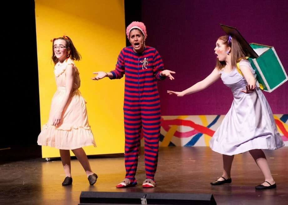 "STEVEN SIMPKINS/Daily NewsArlo Turpin as Dina, Helena Donoso as Pam the Teacher and Ella McKane Wright as Schulie in the H.H. Dow High School production of ""Schoolhouse Rock!"""