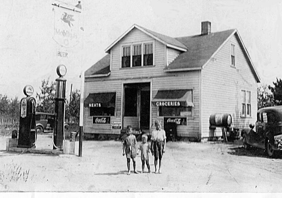 Here is a photo of the original Renshaw Grocery Store on the corner of U.S. 10 and Stark Road before the freeway went through. The family lived in the back of the store with the living room and kitchen in the back of the store and three bedrooms upstairs. Renshaw's Grocery Store and Gas Station became a gathering place for friends and neighbors.