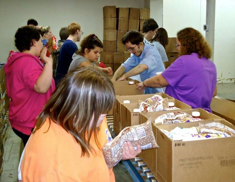 Photo providedBoxes of food are packed by students from the Clare-Gladwin Regional Educational District and contain cheese, cereal, canned fruits and vegetables, canned meats, peanut butter, non-fat dry and evaporated milk and juices.