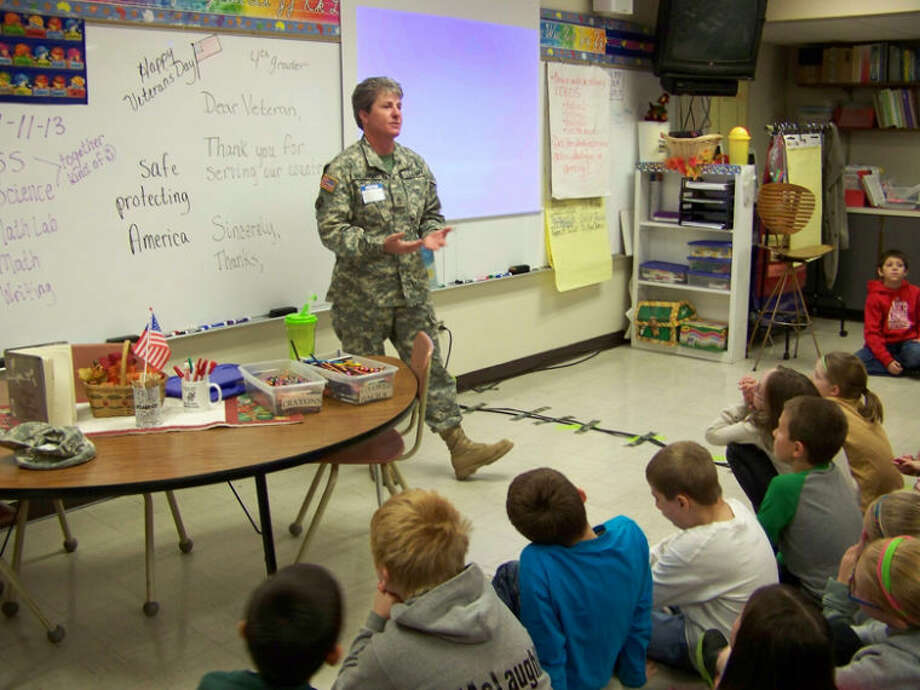 Photo providedArmy Sgt. 1st Class Camie Sherwood speaks to students at Pine River Elementary School.