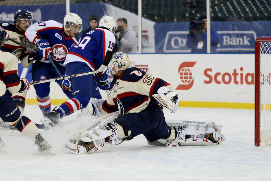 NICK KING   nking@mdn.netSaginaw goalie Nikita Serebryakov saves a Windsor shot on goal during the second period Sunday at Comerica Park in Detroit. Windsor won the Winter Classic game 6-5. Photo: Nick King