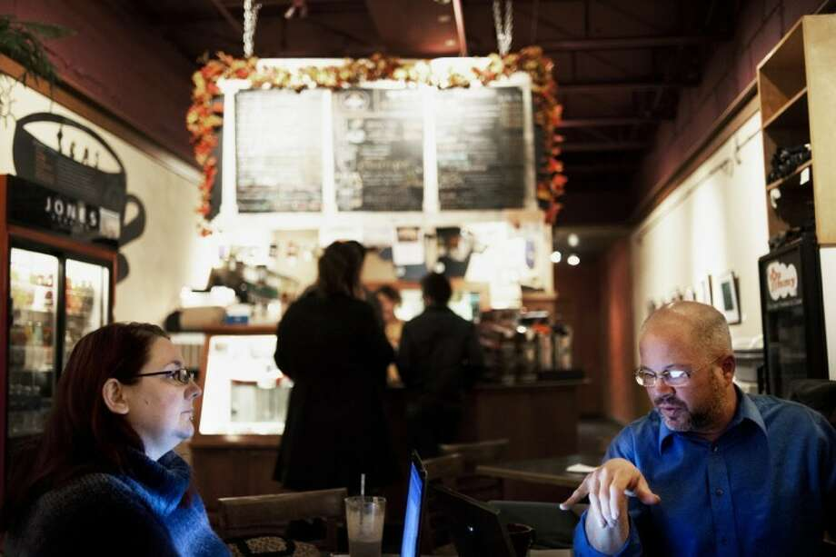 Zack Wittman | for the Daily NewsJim Schmitt of Midland discusses his in-progress novel with Catrice Thornton of Midland at Espresso Milano during the Tridge Troll writing group's write in on Thursday. November is National Novel Writing Month, giving authors the motivation to start or complete a novel this month.