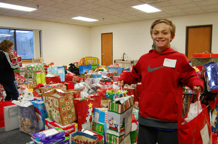 Photo providedOne of Santa's helpers works during the Sharing Tree toy distribution day. There is still time to give a Sharing Tree gift to someone in need in Midland County. Gift tags are available at the United Way of Midland County office in downtown Midland.