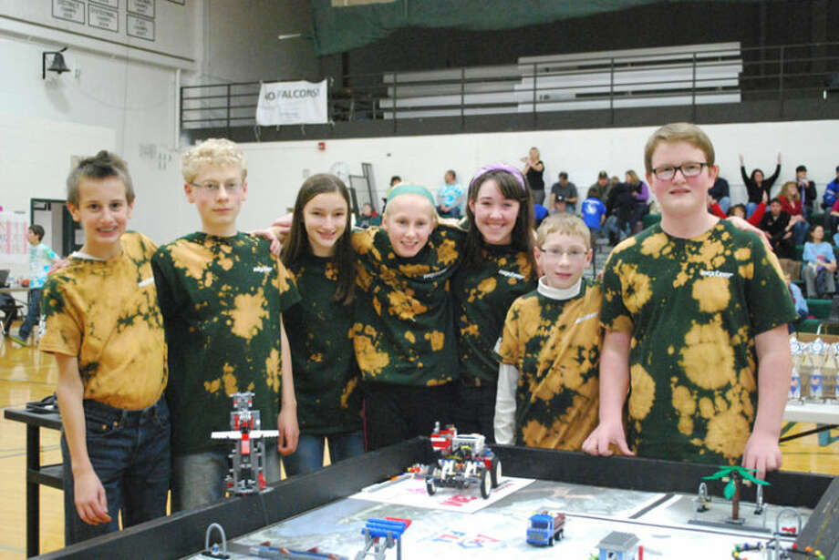 Photo providedMembers from NEXtreme team at Northeast Middle School are, from left, Kenny Steinhilber, Alex Feige, Emily Yoder, Maya Albright, Lauren Smit, Nick Feige and Logan Brubaker. The NEXtreme team and three others from Midland Public Schools are competing in the state competition on Saturday.