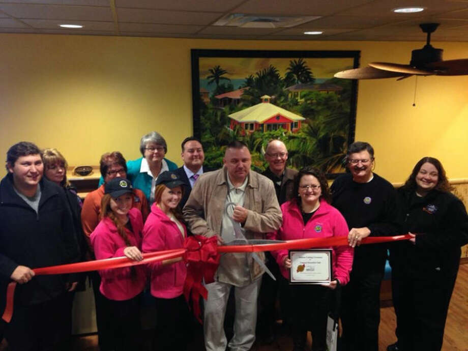 Tropical Smoothie Cafe owner Paul Pococke, center with scissors, at the Midland Area Chamber of Commerce ribbon cutting. The Cafe, at 6805 Eastman Ave., sits behind Olive Garden across from the Midland Mall.