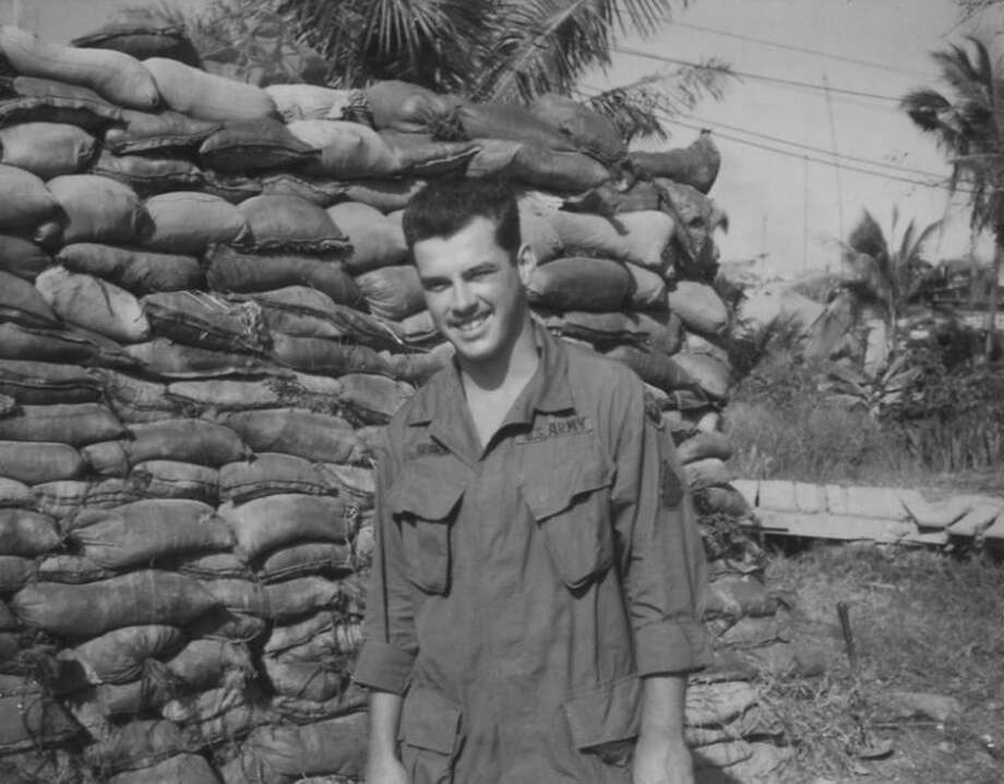 Rod Sparks stands by a bunker made from sand bags, which provided some protection for the soldiers