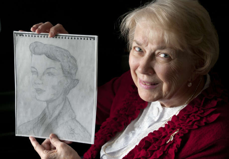 AP Photo | The Saginaw News, Jeff SchrierSue Ambrose, of Auburn, holds a copy of a drawing she made in the early 1950s when she was a teenager. She drew a portrait of a woman, Martha Lee McClintock, from a photo that appeared in a magazine. More than 60 years later, Ambrose's daughter, who now lives in Burbank, Calif., become friends with a woman who lived nearby, and that woman turned out to be the same Martha. The photo was Martha's engagement photo from the 1950s. Photo: Jeff Schrier