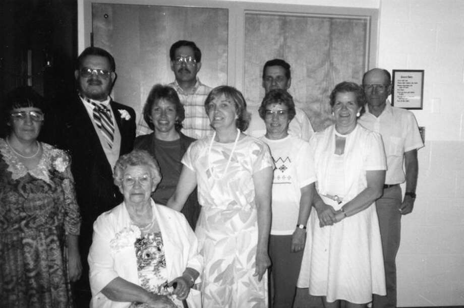 Pictured are the Renshaw children grown up and married. Left to right are JoAnn and Rich Renshaw, Carolyn and John Butcher, Betsy Jackson, Don and Rena Kennedy and Bob and Jean Graham. In the front seated is their mom, Eola Briggs Renshaw.