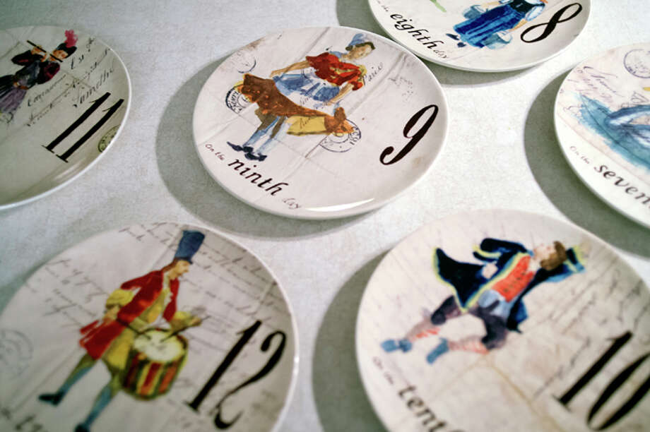 "NICK KING | nking@mdn.net Jean Tobola, of Gladwin, has a ""Twelve Days of Christmas"" collection that she has been accumulating for 20 years, including these collector plates. Jean has various ornaments representing each day, books, and other items, including clothing, with the holiday song theme. Photo: Nick King/Midland  Daily News / Midland Daily News"