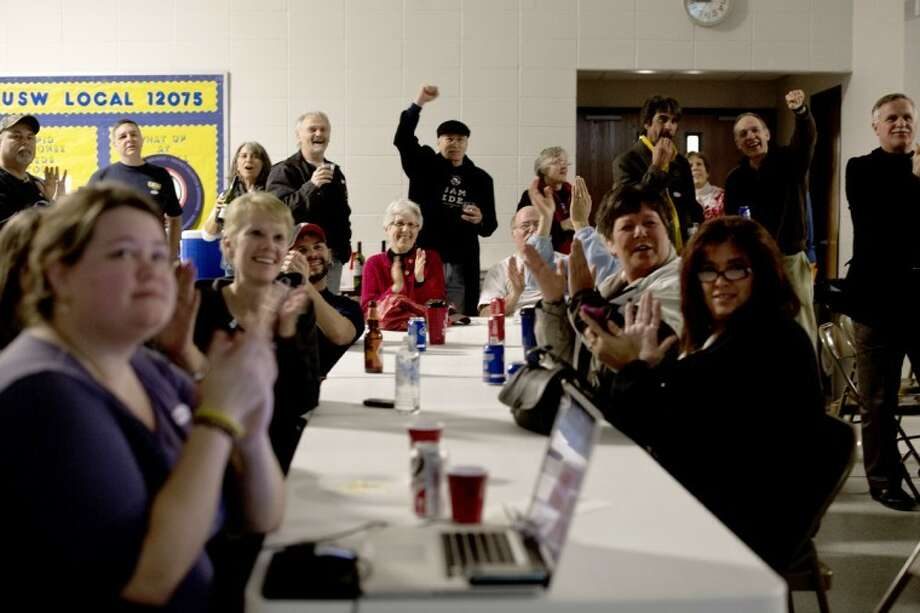 SEAN PROCTOR | sproctor@mdn.netLocal Democrats cheer after hearing the news that President Barack Obama had won Michigan Tuesday evening during a Democratic election party at the United Steelworkers Union Hall. Photo: Sean Proctor
