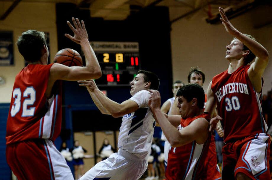 SEAN PROCTOR | sproctor@mdn.netColeman's Matt Warner looks to pass against Beaverton Monday during their game at Coleman High School. Photo: Sean Proctor/Midland  Daily News