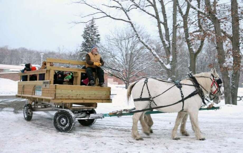 Photo providedA horse-drawn wagon ride was one of the activities offered during the Mid Michigan Community College Christmas party.