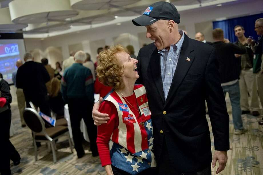 NICK KING | nking@mdn.netU.S. Rep. Dave Camp, R-Midland, visits with supporter Ethel Blust during a Republican gathering at The H Hotel in Midland. Camp beat Democrat Debra Wirth in the 4th Congressional District race. Photo: Nick King/Midland  Daily News