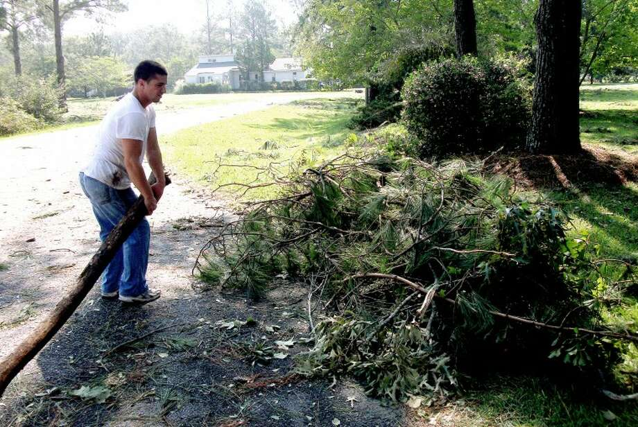 Christopher Morden clears branches from his property following Hurricane Irene. Photo: Photo Provided