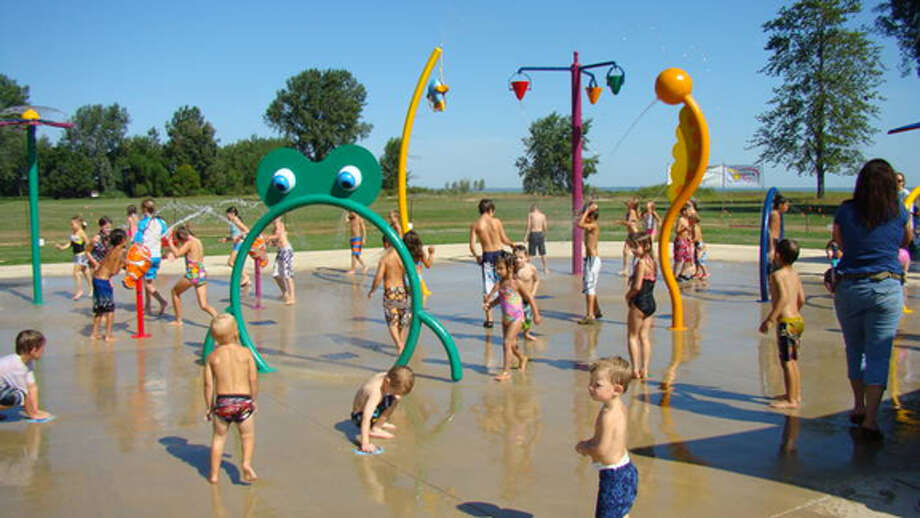Kids play at the Bay City Spray Park in this undated photo. Photo: Photo Provided