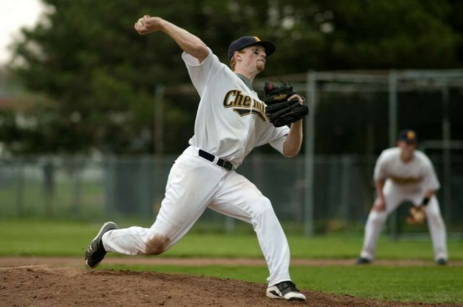 NICK KING   nking@mdn.net Midland's Nick Mammel throws a pitch to a Heritage batter in the sixth inning Thursday at Midland High School. Midland won the first game of a doubleheader 11-5. Photo: Nick King/Midland  Daily News