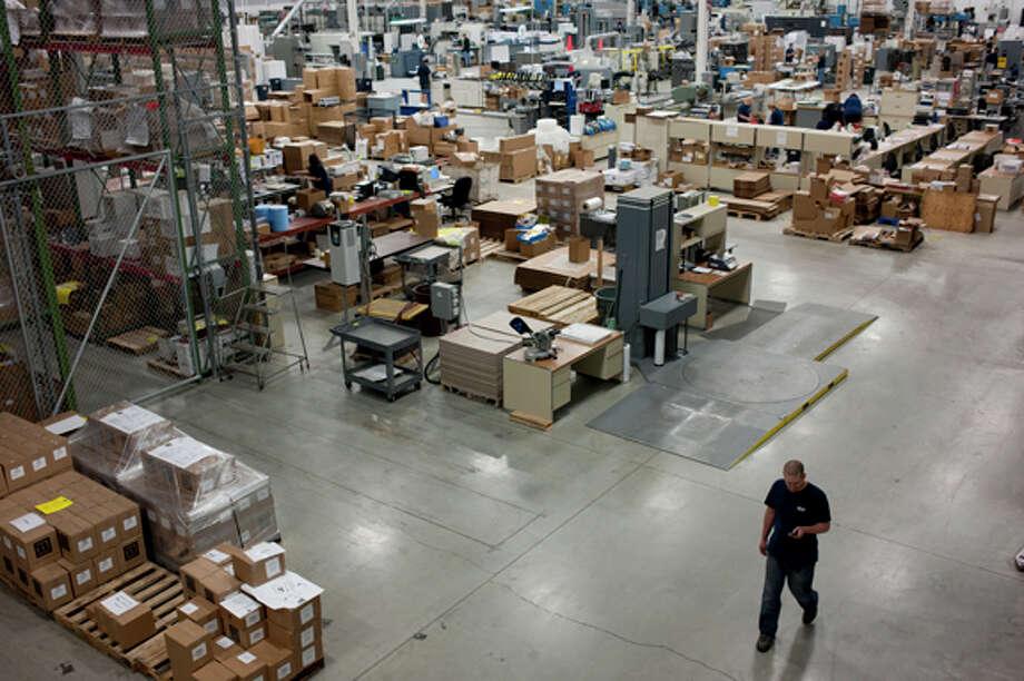 A worker walks through the McKay Press building in Midland. Photo: Thomas Simonetti/Midland  Daily  / Midland Daily News
