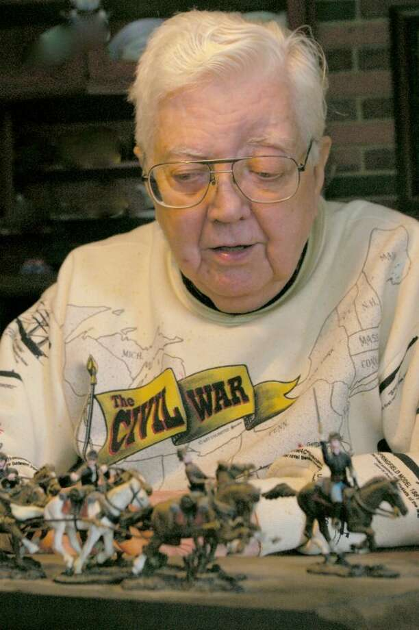 Stu Frohm | for the Daily NewsRalph Sitter, 88, of Midland looks at some of the Civil War miniature soldiers and horses he assembled and painted. Two of his great-grandfathers were Union soldiers, and other relatives served during the American Revolution, Boxer Rebellion, Spanish-American War and World War I.