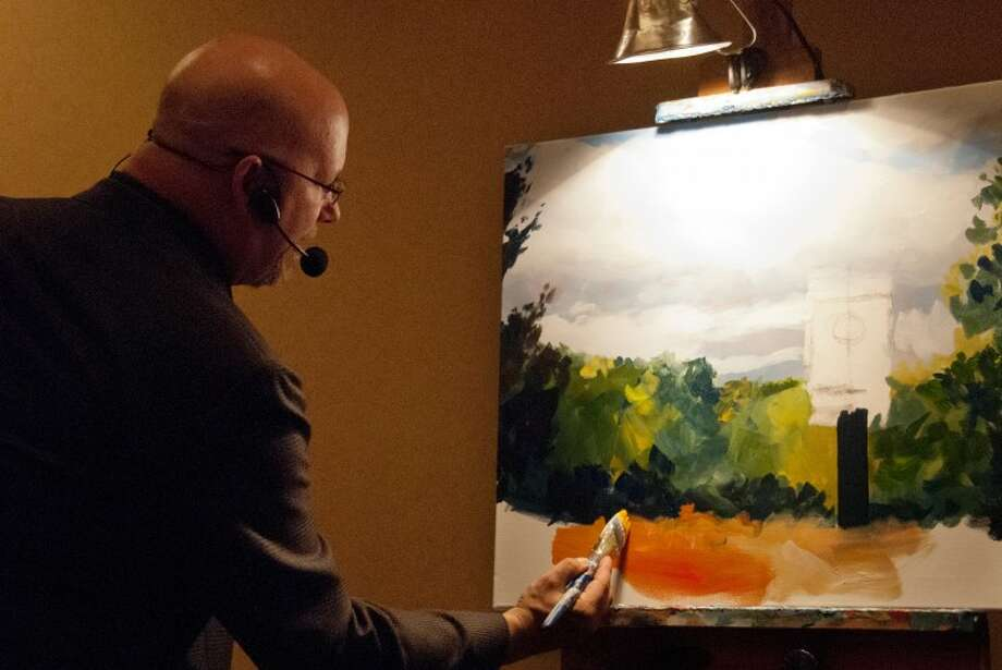 "STEVEN SIMPKINS/Daily NewsMike McMath of ""Empty Canvas""works on a painting at The Little Forks Conservancy's Green Tie Gala. The painting was sold at the end of the evening as part of the live auction."