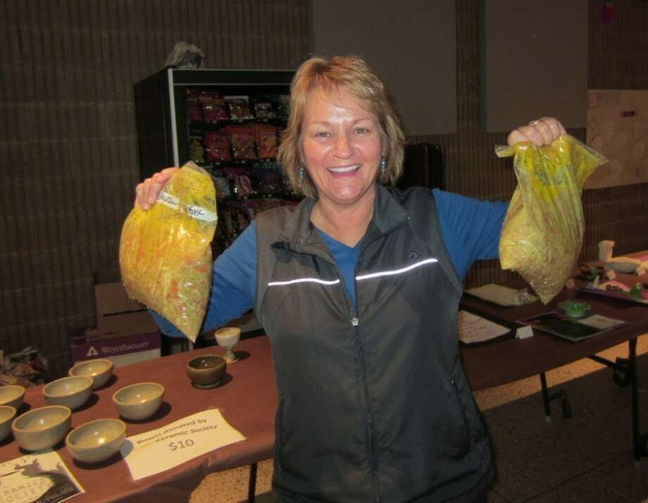 Photo providedS.P.A.R.K.S. Director Carol Westjohn is shown at the Empty Bowls Dinner fundraiser that netted nearly $2,000 for a food giveaway April 26.