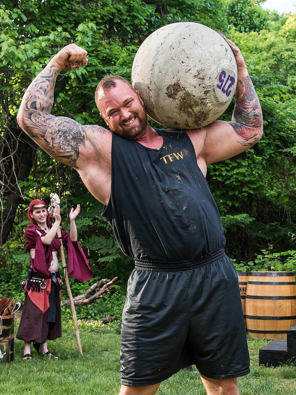 Before he began tossing 215-pound stones around, a much thinner Bjornssondunked basketballs as a pro-basketball player in Iceland. He also was a member of the Division 2 Icelandic national hoops team.