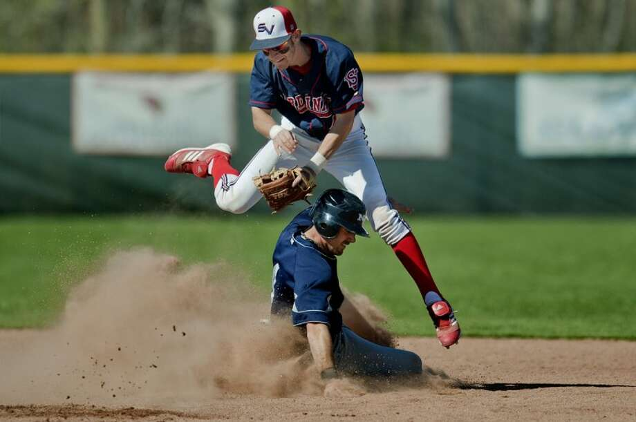 NICK KING | nking@mdn.netNorthwood's Jake Oard slides under Saginaw Valley State's Kyle Parks during the seventh inning Wednesday at SVSU. Oard was called out on the play. Photo: Nick King/Midland  Daily News