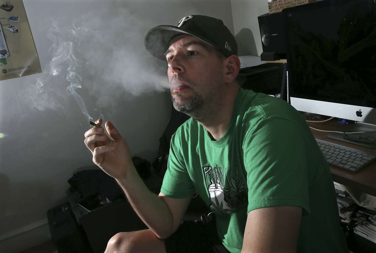 In this March 10, 2016, photo,f ormer U.S. Marine, Mike Whiter smokes marijuana before he starts editing a video project at his home in Philadelphia. A growing number of states are debating whether to legalize marijuana for the treatment of post-traumatic stress disorder. But for an increasing number of veterans, the debate is over. They�re using marijuana to alleviate PTSD-induced nightmares and anxiety, even it�s banned by the federal government and remains illegal in their state. The trend raises questions about marijuana�s safety among a vulnerable group of veterans at a time when major studies have yet to prove the drug�s effectiveness. (AP Photo/Mel Evans)