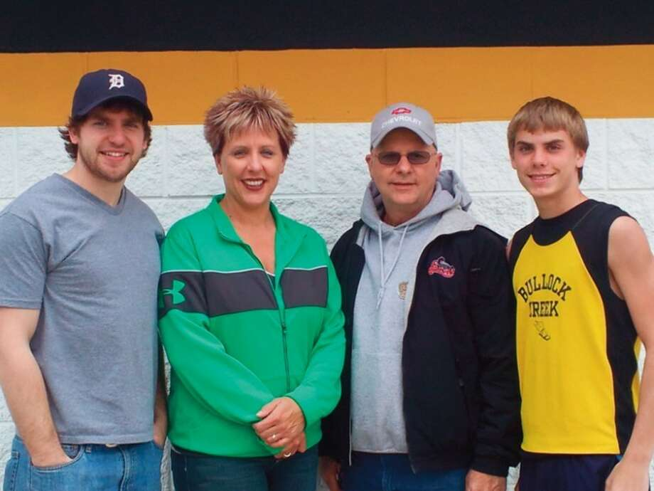 Photo providedFrom left, Josh Rickett, Kelly Biggs, Dave Rickett, and Chandler Biggs will all race in Saturday's 5K run at the Great Lakes Loons Pennant Race. Dave Rickett is Kelly Biggs's father, and Josh Rickett and Chandler Biggs are his grandsons.