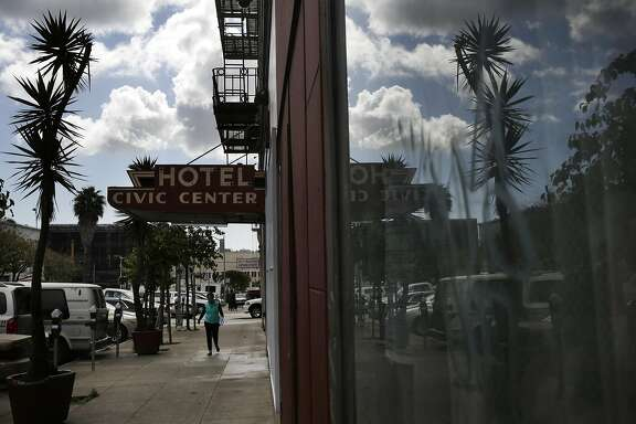 A pedestrian walks past the Civic Center Hotel March 22, 2016 in San Francisco, Calif.