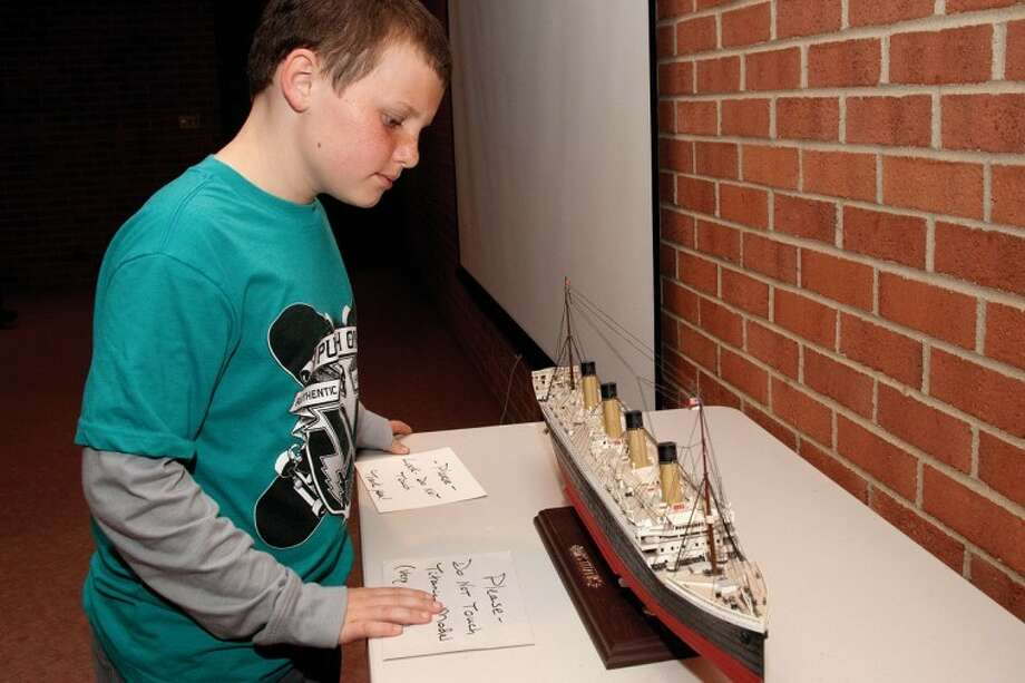 STEVEN SIMPKINS | Daily NewsMark Merril examines a detailed scale model of the Titanic. Nationally recognized Titanic authority and Midland native Floyd Andrick gave a program on the ship and some of its survivors at the Midland Center for the Arts Thursday.
