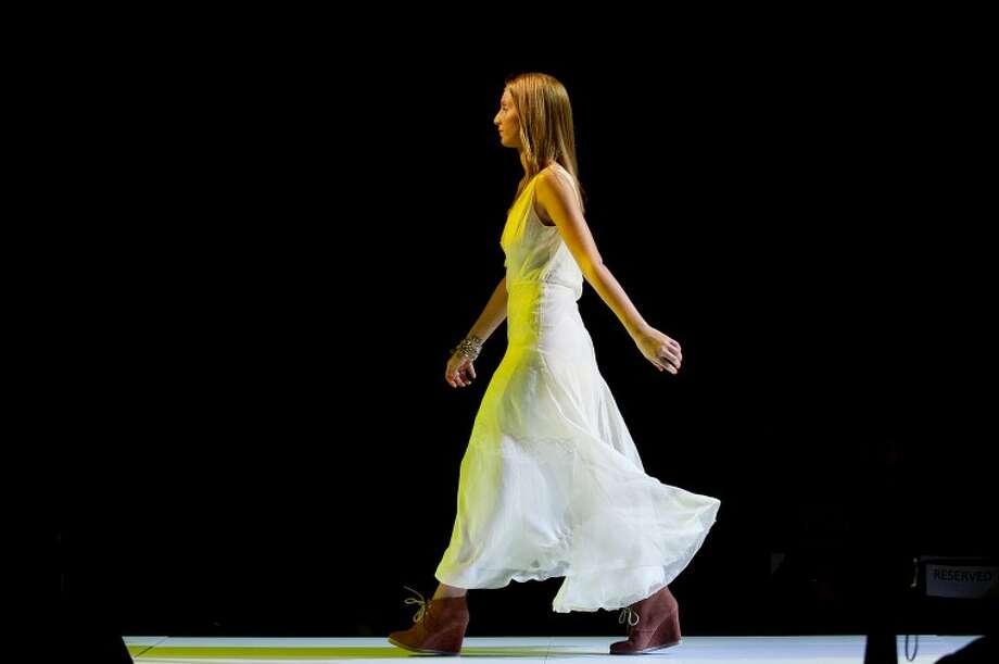 NEIL BLAKE   nblake@mdn.netNorthwood University student Meghan Montgomery models on the runway at Muse, the university's 11th annual student-run style show. Photo: Neil Blake/Midland  Daily News
