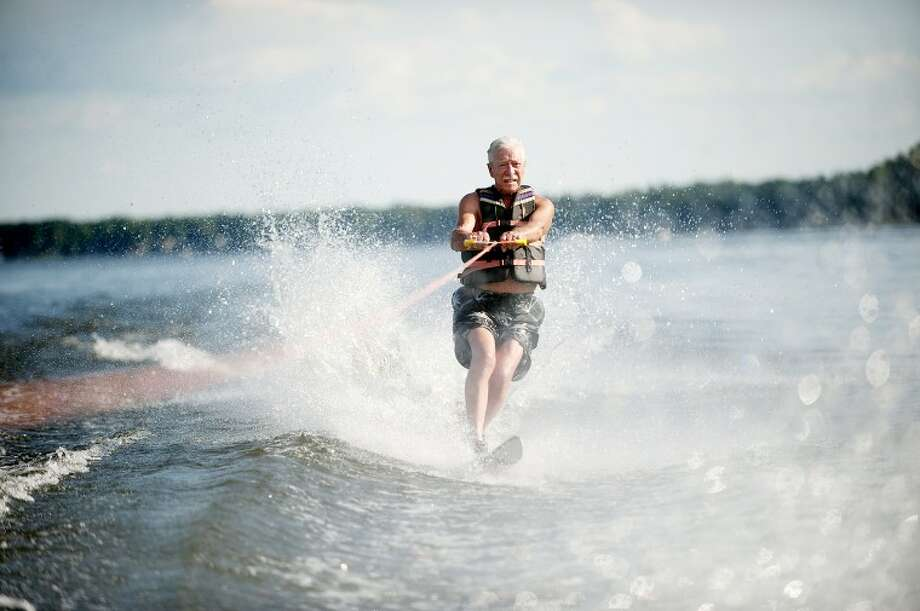 "Adolph Patrzik of Sanford waterskis on one ski at Sanford Lake. The 81-year-old says he does a series of morning exercises in addition to the waterskiing to stay healthy. ""It's something I feel I want to keep doing until I can't,"" he said. Photo: THOMAS SIMONETTI 