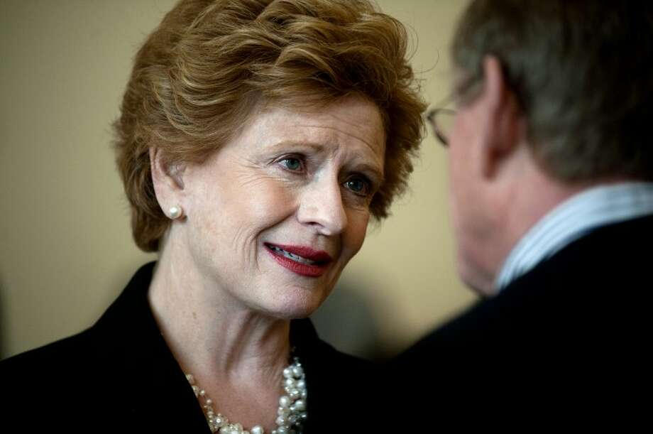NEIL BLAKE | nblake@mdn.net U.S. Sen. Debbie Stabenow talks with Steve LaLonde at the Midland Area Chamber of Commerce Issues and Answers breakfast on Tuesday. Stabenow spoke about Michigan jobs focusing on advanced battery manufacturing and agriculture. Photo: Neil Blake/Midland  Daily News