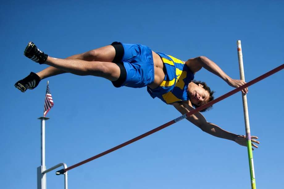 THOMAS SIMONETTI | tsimonetti@mdn.netMidland's Ryan Sugnet clears a jump while competing in the boys pole vault in the Chemic's meet against Saginaw Heritage on Tuesday at Midland High School. Sugnet finished first in the event. Photo: Thomas Simonetti