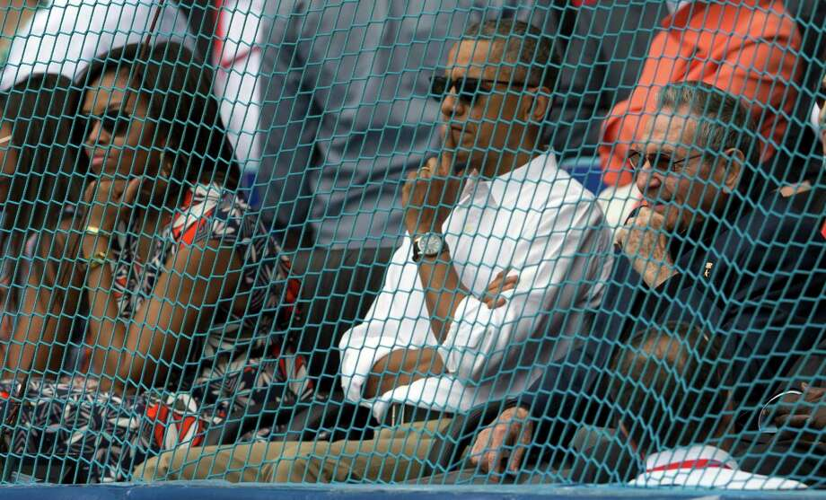 Cuban President Raul Castro, right, U.S. President Barack Obama, and first lady Michelle Obama watch a baseball match between the Tampa Bay Rays and the Cuban national team in Havana, Cuba, Tuesday, March 22, 2016. The crowd roared as Obama and Cuban President Raul Castro entered the stadium and walked toward their seats in the VIP section behind home plate. It's the first game featuring an MLB team in Cuba since the Baltimore Orioles played in the country in 1999. Photo: Ismael Francisco, AP / Cubadebate