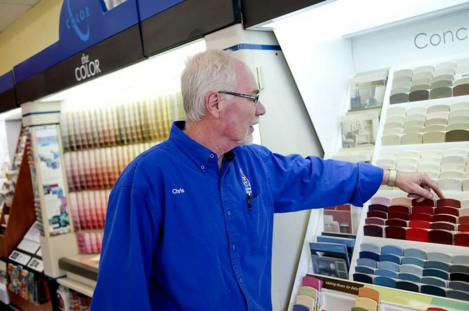 NICK KING | nking@mdn.net Manager Chris Stevens talks about some of the more popular paint colors for homes at the Sherwin-Williams store in Midland. All the paint offered is approved for interior and exterior. Customers can have Sherwin-Williams match existing colors with a provided paint samples, or customers can choose from a variety of colors. Photo: Nick King/Midland  Daily News