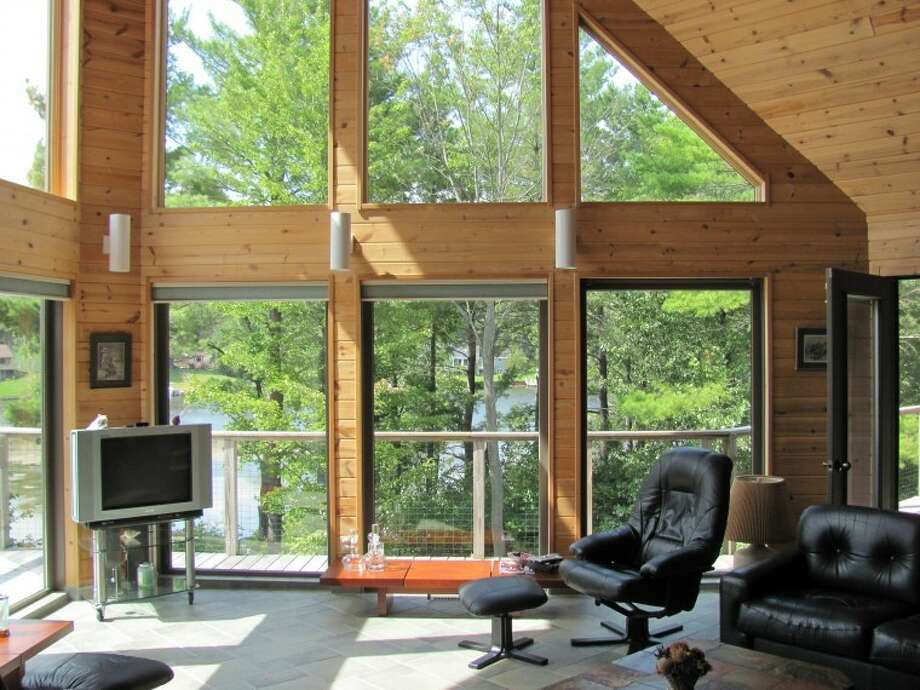 The living room has 22-feet-tall windows.