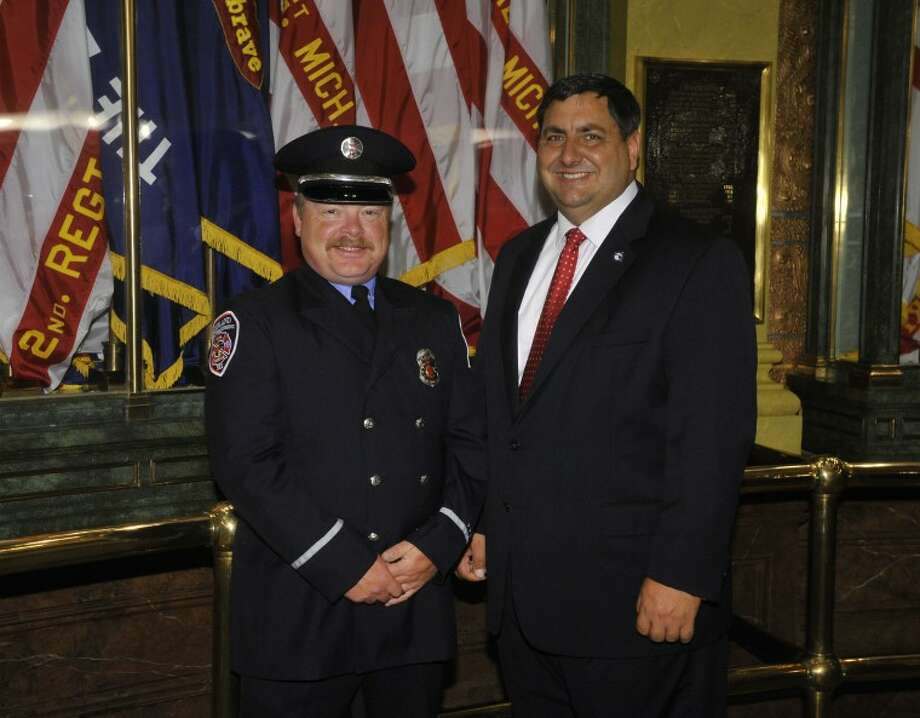 Photo providedPictured are State Rep. Jim Stamas and Midland Fire Department Lt. Rodney Sweet.