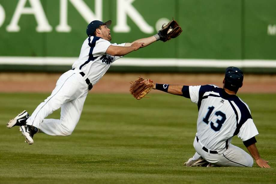 THOMAS SIMONETTI | tsimonetti@mdn.netNorthwood shortstop Jason Fracassa makes a diving catch in shallow center field in the seventh inning against Saginaw Valley on Tuesday at Dow Diamond. Photo: Thomas Simonetti