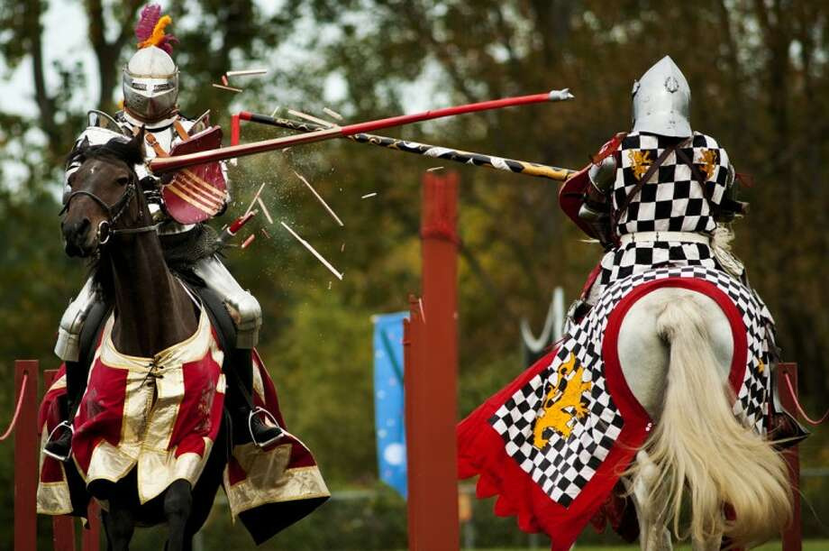 Jason Monarch, right, breaks his lance against Andre Reiner scoring three points during a jousting match Friday morning at the Renaissance Festival at Midland Academy of Advanced & Creative Studies. Monarch and Reiner are both members of the Knights of Iron Joust Team. Photo: SEAN PROCTOR | For The Daily News