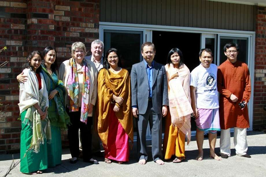 Photo providedNorth American Manipur Association (NAMA) members, along with Molly McFadden of Molly's Bistro in Midland and her husband Brian McFadden, third and fourth from left, pose for a photo at the Cheiraoba celebration.